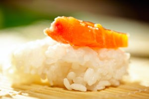 Rice with salmon. Macro shot with beautiful shallow dof illustrating making sushi process.